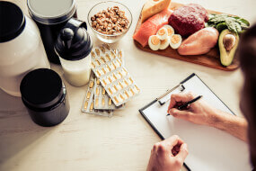 Notepad, healthy food, protein powder, and health supplements