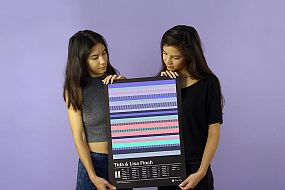 Two sisters holding their DNA print